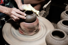 Male hand sculpture pot in pottery Stock Photography