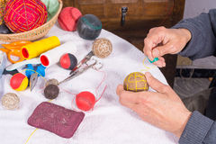 Male hand sewing sport balls Royalty Free Stock Photos