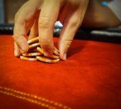 Male hand shaffling poker chips. Nerves in gambling. Male hand shaffling poker chips Stock Image