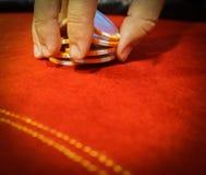 Male hand shaffling poker chips. Nerves and stress in gambling. Male hand shaffling poker chips Stock Image