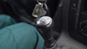 Manual stick shift gearing up. Close-up. Male hand shifts in his car. Manual transmission stock video footage