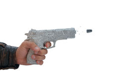 Male hand with shoting newspaper pistol and bullet. On white background. fake Royalty Free Stock Photos