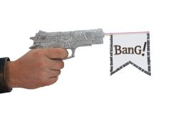 Male hand with shoting newspaper pistol and flag Royalty Free Stock Photos