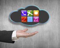 Male hand showing black cloud with colorful app icons Stock Photos