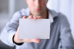 Male hand showing a business card Royalty Free Stock Images