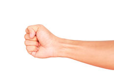 Male hand showing clutched in his fist isolated. On white background Royalty Free Stock Image