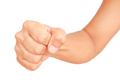 Male hand showing clutched in his fist isolated. On white background Royalty Free Stock Images