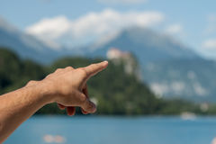 Male hand showing destination on the mountain Stock Image