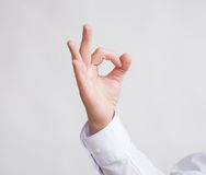Male hand showing a OK sign Stock Photography