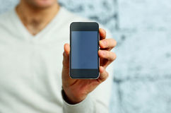 Male hand showing smartphone display Royalty Free Stock Photo