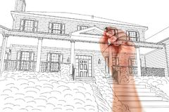 Male Hand Sketching with Pencil the Outline of a Beautiful House. On White royalty free stock photos