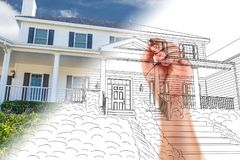 Male Hand Sketching with Pencil the Outline of a House Photo. Male Hand Sketching with Pencil the Outline of a House with Photo Showing Through stock image