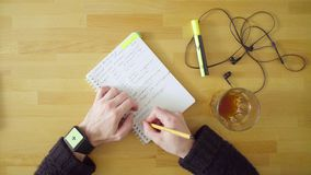 Male hand with smart watch. Green screen. Top view. Man writing in the notebook. Green screen chroma key Stock Image
