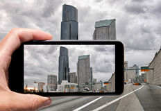 Male hand with smartphone taking a picture of Seattle. Tourism c Royalty Free Stock Photography