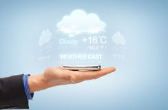 Male hand with smartphone and weather cast Stock Image