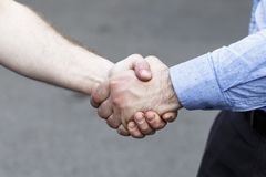 Male hand squeezes the other hand. daylight. have toning stock image