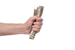 Male hand squeezing tightly some banknotes. On white background Stock Image
