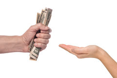 Male hand squeezing tightly some banknotes. On white background Royalty Free Stock Photo