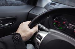 Male hand on steering wheel, car interior. Male hand on steering wheel. Modern car interior Stock Photography