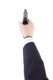 Male hand in suit holding gun isolated on white Royalty Free Stock Images