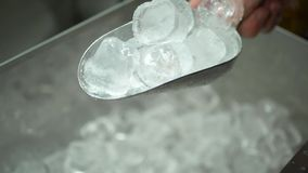 Male Hand Takes Pieces of Ice Cubes