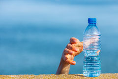Male hand taking away water plastic bottle outdoor royalty free stock photos
