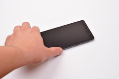 Male hand taking blank mobile smartphone with clipping path for Royalty Free Stock Photos