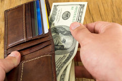 Male hand taking dollar out of wallet Royalty Free Stock Photos