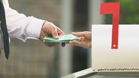 Male hand taking euro banknotes from mail box, remittance service money transfer. Stock footage stock footage