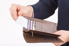 Male hand taking out business card from a wallet Royalty Free Stock Photo