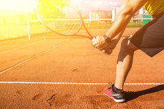 Male hand with tennis racket. Closeup photo of male hand with tennis racket hitting the ball Stock Photos