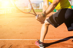 Male hand with tennis racket. Closeup photo of male hand with tennis racket hitting the ball Stock Photography