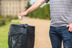 Male hand throw paper tissue in the trash royalty free stock photo