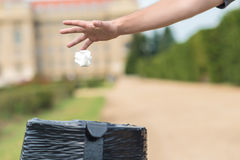 Male hand throw paper tissue in the trash Stock Photos