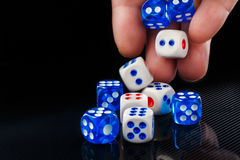 The male hand throwing dices on dark background. The male hand throwing colored dices on dark background Royalty Free Stock Photo