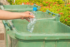 Male hand throwing empty plastic bottle Royalty Free Stock Photo