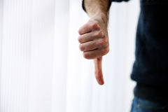 Male hand with thumb down Royalty Free Stock Photo