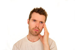 Male with hand to head thinking Royalty Free Stock Photo