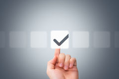 Male Hand Touching Button and Ticking Check Box Royalty Free Stock Images