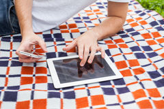 Male hand touching digital tablet pc during rest. Outside photo. Male hand touching digital tablet pc during rest. Outside photo Royalty Free Stock Image