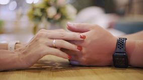 Male hand touching female hand while romantic date in evening restaurant. Woman touching hand girlfriend on table at. Evening dinner in elegant cafe. Romantic stock video