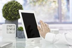 Male hand touching tablet screen Royalty Free Stock Photography