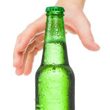 Male hand trying to reach bottle of beer - studio shot over a white - 1 to 1 ratio Stock Photos