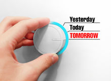 Male hand turns the switch. Switches days. Chose the Tomorrow.  Stock Image