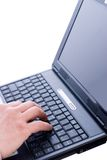 Male hand typing on a laptop Stock Photography