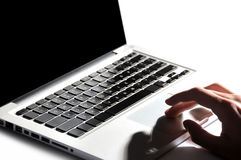 Male hand typing in laptop Stock Photography
