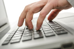 Male hand typing on laptop Stock Images