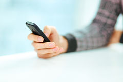 Male hand typing on smartphone Stock Photography