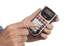 Male hand using calculator. Male hand pressing buttons on a calculator. Isolated on white Stock Photos