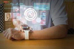 Male Hand using Digital Wireless Smart Watch with Virtual Realit Stock Image